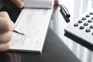 WalletHub Report: Annual Checking Account Costs Can Exceed $700
